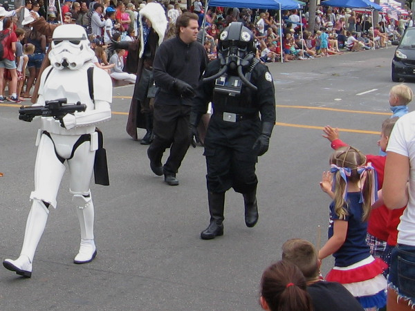 Kids wave at Star Wars stormtrooper and tie fighter pilot at the Coronado Independence Day parade!