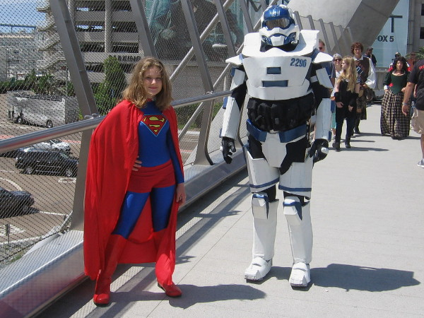 Supergirl crosses the Harbor Drive bridge with a cool companion. Is that some sort of Star Wars stormtrooper.