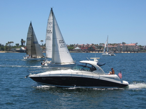 A pleasure boat, two sailboats, one catamaran--everyone is out on glorious, blue San Diego Bay.