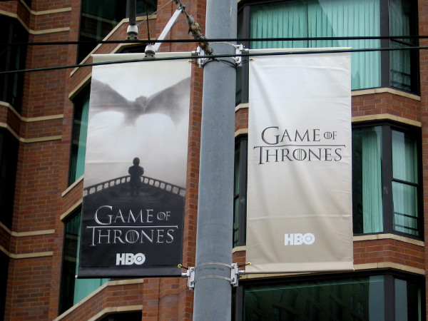 Game of Thrones banners on trolley electrical poles along Martin Luther King Jr. Promenade in San Diego.
