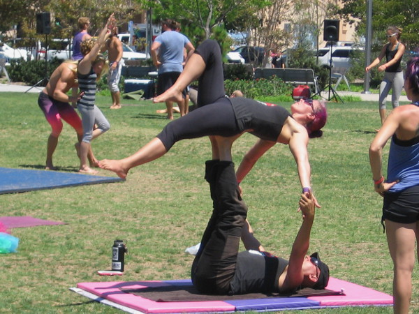 Practicing acrobatic skills at the AcroLove Festival in San Diego's Ruocco Park.