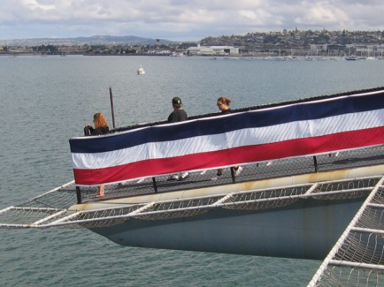 Tourists at USS Midway Museum walk out onto one of the two horns that project over San Diego Bay.
