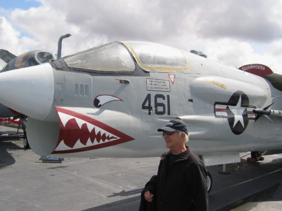 Man lingers near F-8 Crusader, the US Navy's first supersonic fighter.