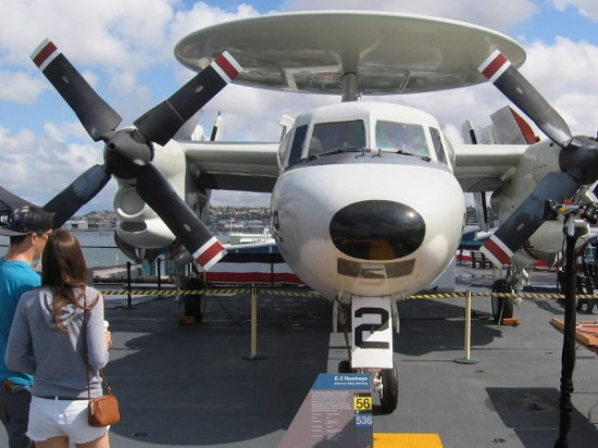Young couple takes a look at E-2 Hawkeye, an Airborne Early Warning aircraft.