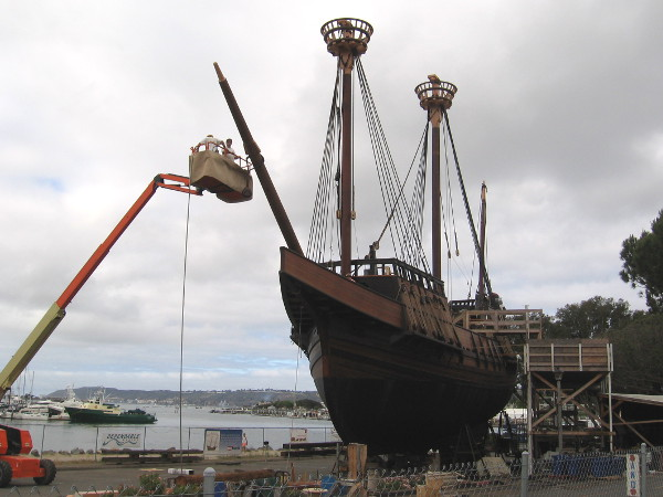 Maritime Museum of San Diego volunteers work on the bowsprit, before San Salvador is eventually moved onto a barge, then hoisted at a local shipyard into the bay.