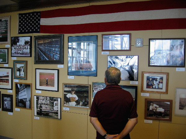 Visitor to eighth floor of San Diego's downtown public library checks out photographs in the Sullivan Family Baseball Research Center.