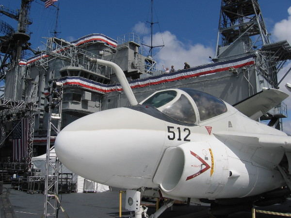 A-6 Intruder bomber on display near USS Midway's superstructure.