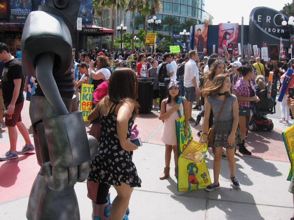 A huge crowd of Comic-Con enthusiasts has assembled at the entrance to San Diego's Gaslamp Quarter.