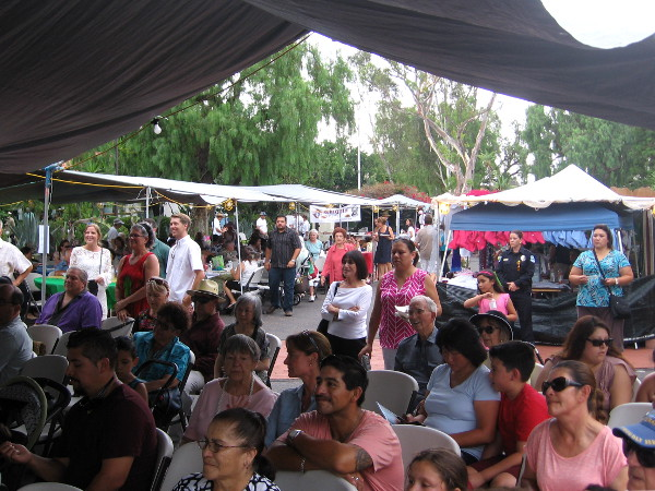 A large audience had gathered in the mission's spacious courtyard, even as rain threatened on Sunday afternoon.
