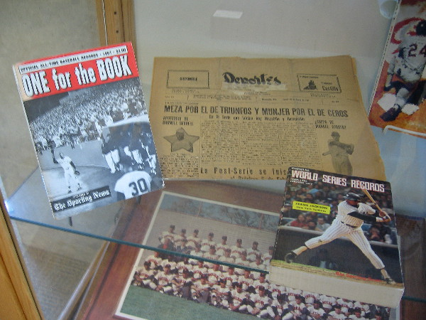 Another exhibit, with an old newspaper, World Series Records, Sporting News publication, team photograph.