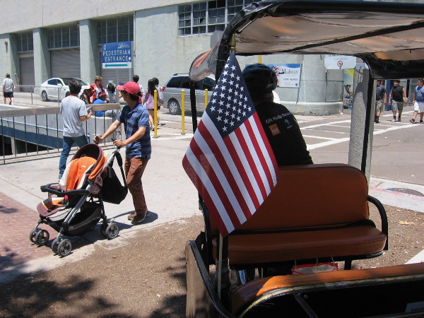 American flag on a pedicab waiting for passengers by the USS Midway Museum.