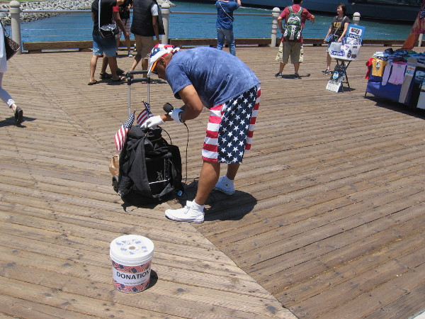 A street performer wears the Stars and Stripes. Looks like he's ready to go this Fourth of July weekend.