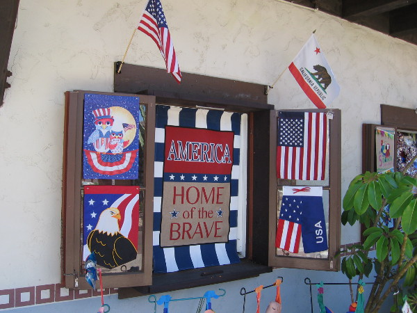 Window at Alamo Flags in Seaport Village has patriotic displays. Mike Ismail, the owner, is proud and grateful to be a free American.