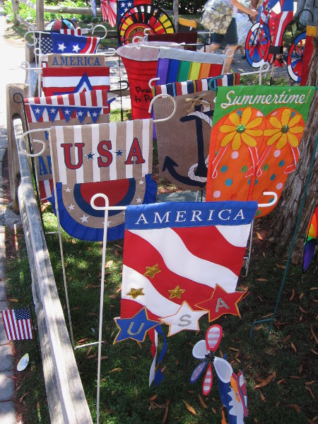 Banners near front of Alamo Flags. The shop will give away 1000 free actual United States flags on the Fourth of July!