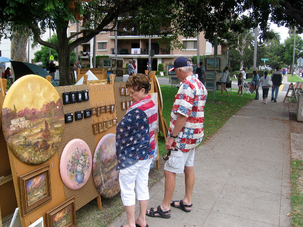People check out art on display in Spreckels Park.