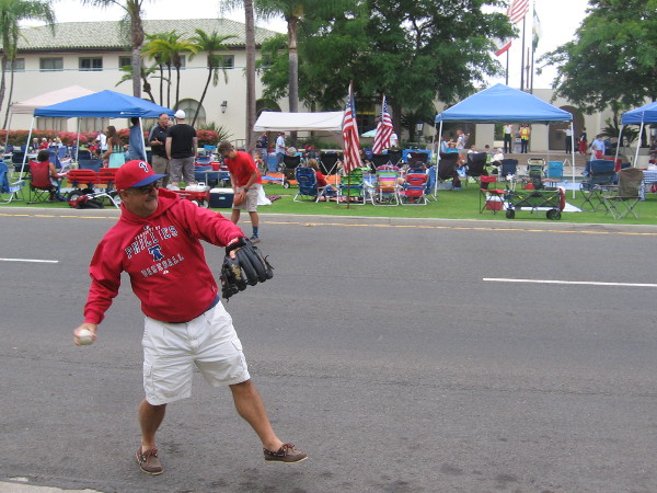 What could be more American than tossing a baseball while waiting for the big parade to begin.