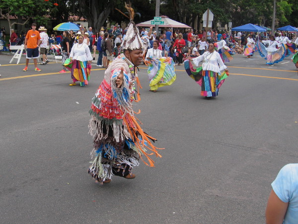 A colorful costume gets onlookers in the mood for a big, fun parade.