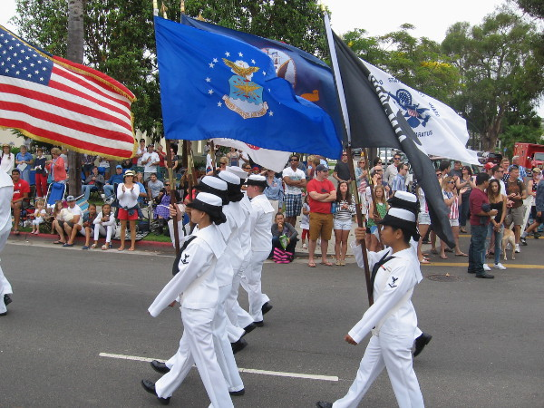 A color guard precedes honored Pearl Harbor survivors.