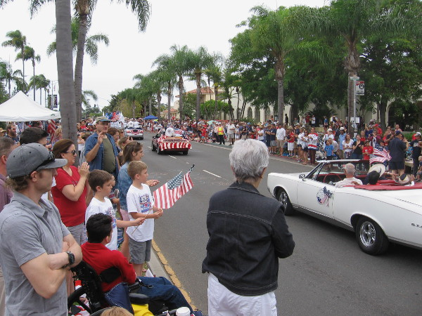 Applause for the Pearl Harbor survivors as they pass on by for the Fourth of July.