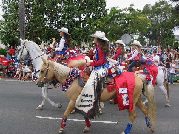 Here come the Valley Center Rodeo Queens on horseback.