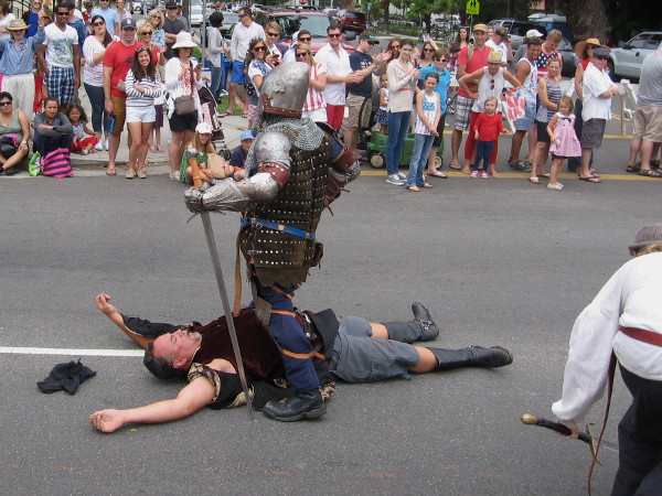 Some medieval knights did battle on the parade route. Seems one has emerged the victor.