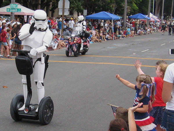 Imperial stormtrooper rides a Segway, an advanced land vehicle from the early 21st century.