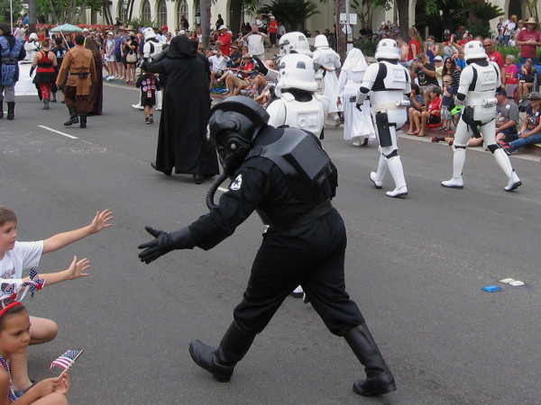 Kids have a load of fun as costumed Star Wars enthusiasts participate in the Coronado Independence Day parade.