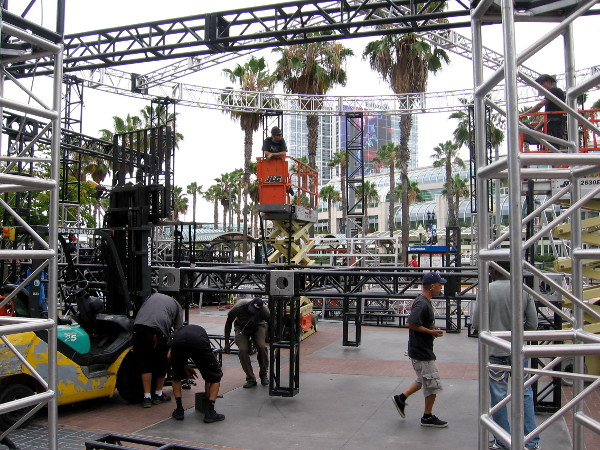 Guys build steel structure near entrance to the Gaslamp Quarter, the hub of Comic-Con activity.