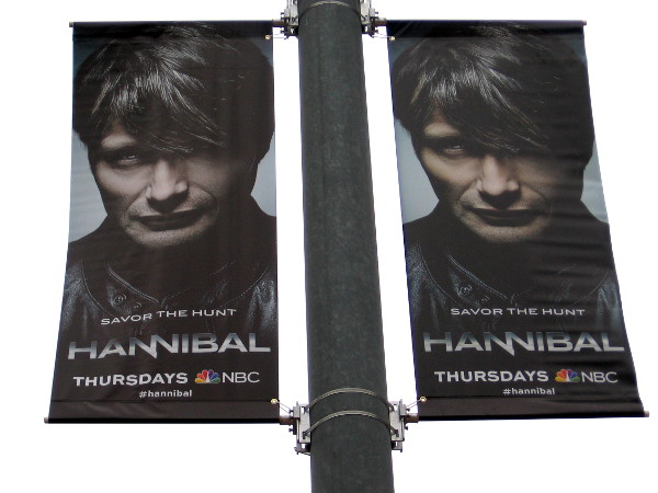 Hannibal. Savor the Hunt. Creepy banners hung at the Gaslamp trolley station.