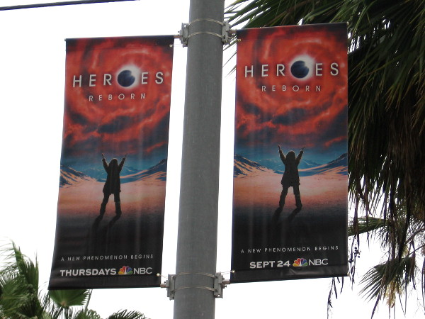 Banners at Gaslamp trolley station promote Heroes Reborn, on NBC.