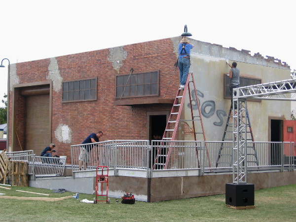 Behind the San Diego Convention Center, workers prepare a scary looking building, part of the FX Fearless Arena Experience.