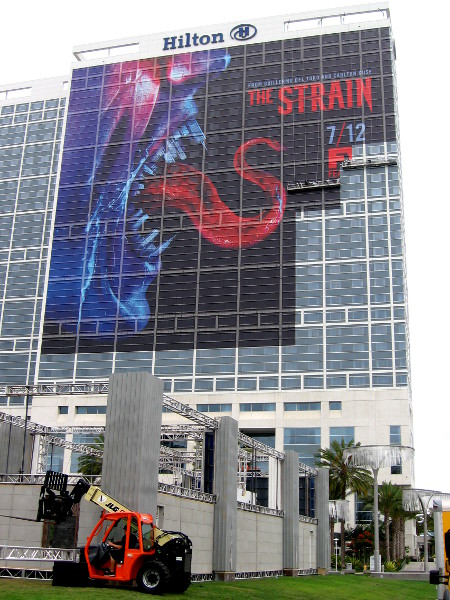 The Strain building wrap on the Hilton is nearing completion, two days before Comic-Con begins.