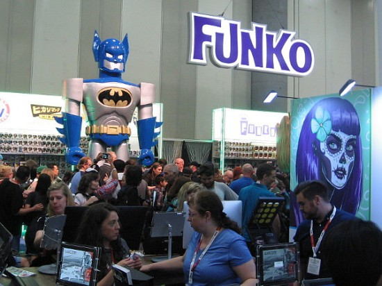 A super cool Batman towers above the crowd in the Funko area.