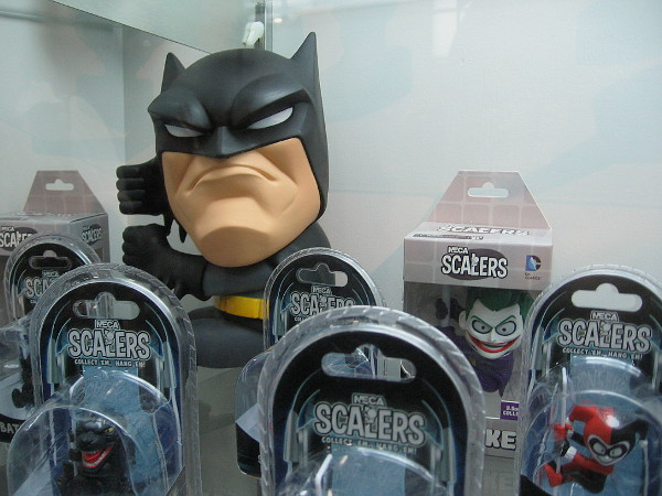 This proud Batman just has to suck it up, surrounded by lesser figures.