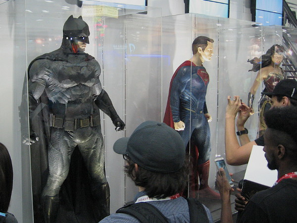 DC's big three superheroes on display on the San Diego Convention Center floor. Batman, Superman, Wonder Woman.