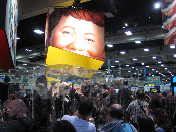 Alfred E. Neuman looks down on huge crowds pressing through hundreds of cool Comic-Con exhibits.