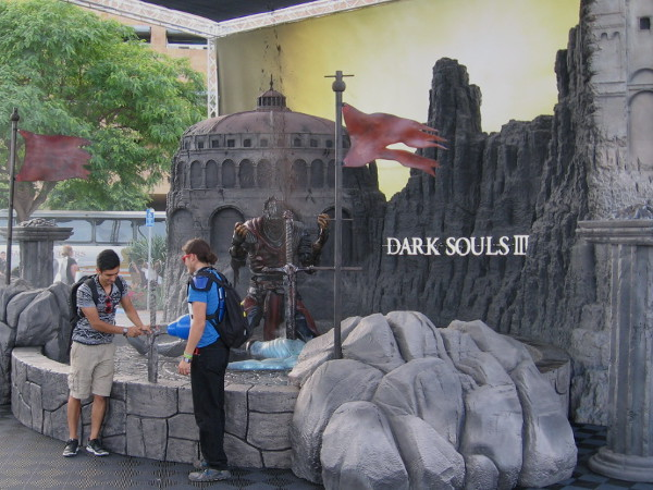 Dark Souls III has a cool backdrop at the Comic-Con Interactive Zone next to Petco Park. Can these guys remove the sword from the stone wall.
