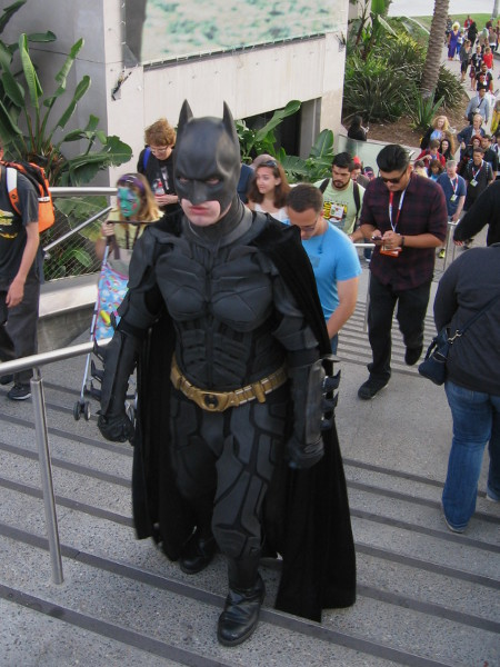 Batman has seen enough of this rabble. He's looking grim and determined to do something.