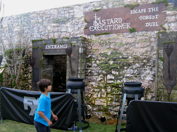 Kid checks out vacant entrance to the Bastard Executioner venue. Escape the forest duel.