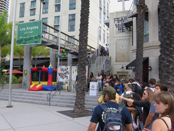Comic-Con goers lined up to experience rampaging zombies at Walking Dead offsite venue at Hilton Gaslamp.