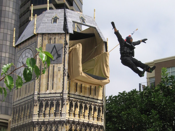 Cosplay ninja takes a flying plunge from the top of the clock tower at Assassin's Creed obstacle course.