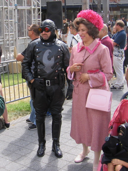 I think that's Dolores Umbridge from Harry Potter. Who's the guy with her? He looks familiar.