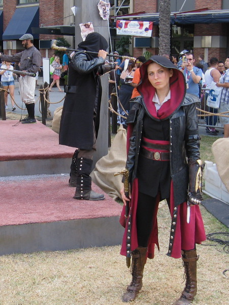 A hooded lady assassin gives me a calculating stare from the Ubisoft Assassin's Creed obstacle course.