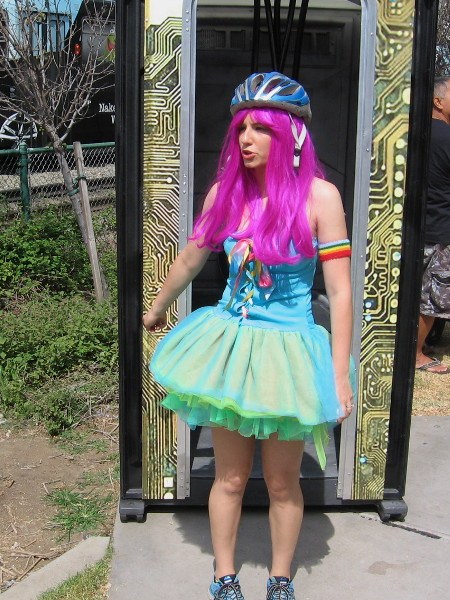 A colorfully dressed cosplayer has checked out the funny, high tech portable toilet prop from Insurgent.
