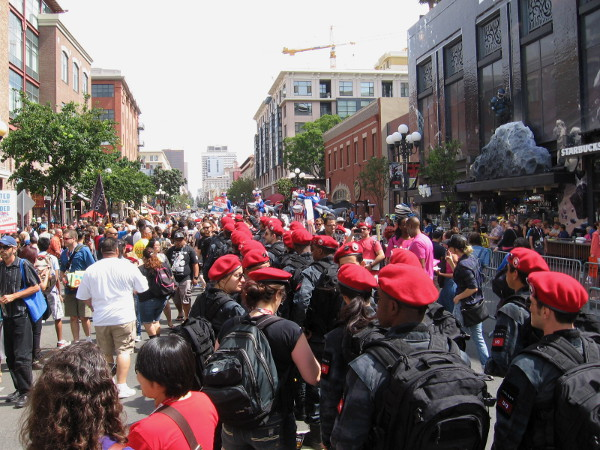 Red-bereted soldiers from Colony television show march in file up Fifth Avenue through San Diego's Gaslamp.