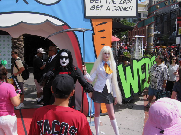 I believe the face-painted cosplay that looks kind of like the rock band Kiss is a character from Korean comics.