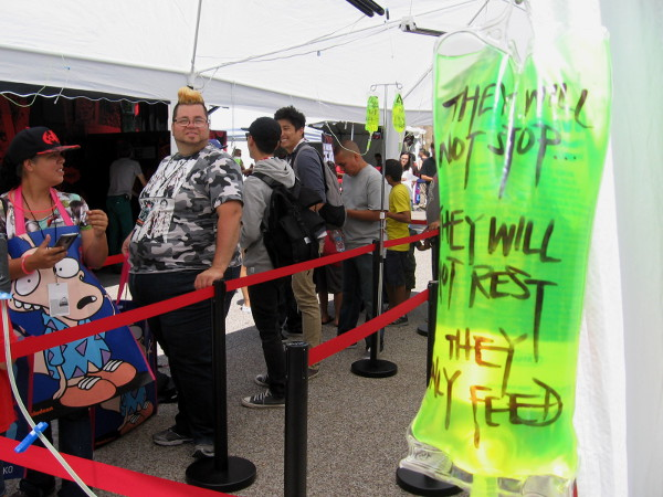These brave people lined up near Petco Park's scary The Walking Dead Escape will experience zombies in virtual reality!