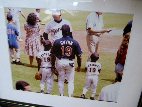 Wonderful photo of San Diego Padres legendary Hall of Fame player Tony Gwynn with his family out on the playing field.