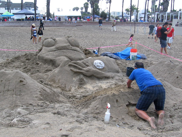 Cool froglike creature coming to life on the beach conveys a Help Conserve Water message.