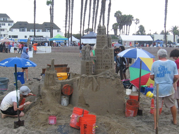 The Sandcastle Man team is building an elaborate sandcastle! Of course!